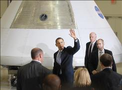 President Obama walks by the Orion capsule at Kennedy Space Center.