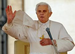 Pope Benedict XVI blesses the crowd at the end of his weeckly audience in St. Peter's square at the Vatican on Wednesday.