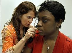 Amanda Cockrell, 32, left, a nurse practitioner at Rush Lifetime Medical Associates, examines Shanequa Reeves, 18, in Chicago.