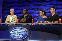 2010 Season 9 American Idol judges Ellen DeGeneres, left, Randy Jackson, Kara DioGuardi and Simon Cowell.
