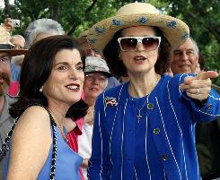 In this Aug. 27, 2008, file photo, Luci Baines Johnson, left, and her sister Lynda Johnson Robb talk during ceremonies to commemorate the 100th birthday of their father, former president Lyndon Baines Johnson.