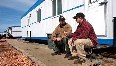 "Michael Wixom, left, and Dan Seiler are two of about 300 oil workers living in a ""man camp"" in Stanley, N.D."
