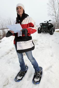 Census worker Danielle Forino uses an all-terrain vehicle and snow shoes in Fort Kent, Maine, to deliver questionnaires to camps in remote sections of the North Maine Woods. Maine and Alaska require special arrangements to reach remote locations to deliver Census forms. Alaska currently has the lowest Census response rate in the country.