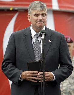 In this 2009 photo, Franklin Graham prepares to give the invocation before the NASCAR Coca-Cola 600 auto race at Lowe's Motor Speedway in Concord, N.C.