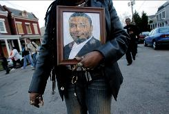 The Churchill community in Richmond, Va., gathers during a tribute for pastor Apostle Anthony L. Taylor (seen in the photo) on March 30. Taylor was killed when his vehicle was hit during a police chase.