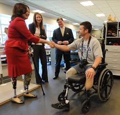 Former Army helicopter pilot Tammy Duckworth, who was injured in Iraq, shakes hands with Army Sgt. Derick Hurt after being sworn in as assistant secretary for Department of Veterans Affairs at a ceremony at Walter Reed Army Medical Center on May 20, 2009.