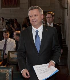 Nebraska Gov. Dave Heineman walks into the Governors Hearing Room  in Lincoln, Neb., on April 13, to sign into law two landmark abortion  bills that both sides of the abortion debate say are firsts in the  country.