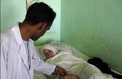 A medic checks on a schoolgirl in a hospital in Kunduz, north of Kabul, Afghanistan.