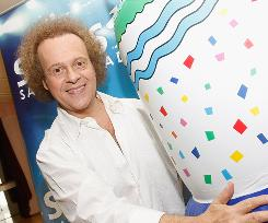 """I have to be a good example,"" World Fitness Day participant Richard Simmons says."