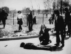 Mary Ann Vecchio gestures and screams as she kneels by the body of a student lying face down on the campus of Kent State University, Kent, Ohio on May 4, 1970. National Guardsmen had fired into a crowd of demonstrators, killing four.