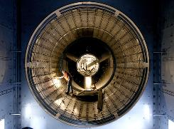 PG&E engineer Stephen Eley inspects a gas turbine at a Maxwell, Calif., power plant last month.