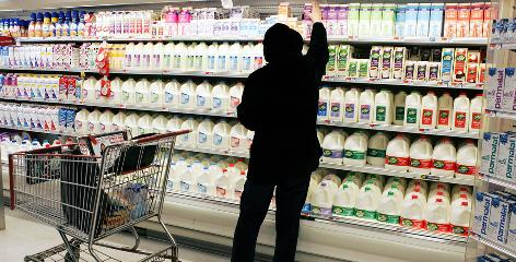 A shopper reaches for a milk product at a supermarket in Lawrenceville, N.J. A national dairy group is petitioning the FDA so that only milk from cows could be labeled as milk.