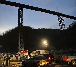 In this April 4, 2010 file photo, West Virginia State Police direct traffic at the entrance to Massey Energy's Upper Big Branch Coal Mine in Montcoal, W.Va., where 29 coal miners were killed in the April 5 explosion.