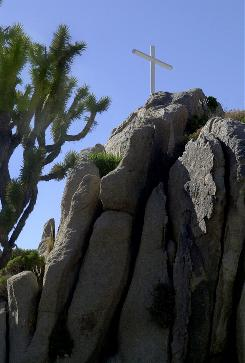 The Veterans of Foreign Wars erected this cross more than 75 years ago atop an outcropping in the Mojave National Preserve. A U.S. Supreme Court ruling Wednesday strengthens the government's effort to keep the cross on public land.