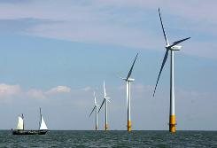A vessel sails toward a wind farm off the coast of Whitstable on the north Kent coast in southeastern England.