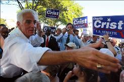 Florida Gov. Charlie Crist greets supporters after announcing that he will make an independent bid for the state's open U.S. Senate seat.