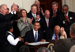 In this March 23 photo, President Obama is applauded after signing the Affordable Health Care for America Act during a ceremony with fellow Democrats in the East Room of the White House.
