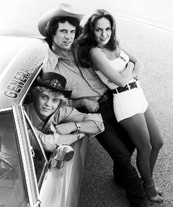 "John Schneider, at left, Tom Wopat and Catherine Bach from TV's ""Dukes of Hazzard."""