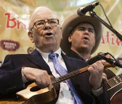Berkshire Hathaway Chairman and CEO Warren Buffett plays the ukulele with the Quebe Sisters Band before an annual shareholders meeting in Omaha, on Saturday.