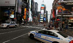 Police cruisers stand by in Times Square on Sunday morning after a potentially powerful bomb was discovered Saturday.