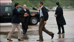 Louisiana Gov. Bobby Jindal, left, greets President Obama at Louis Armstrong New Orleans International Airport on Sunday.