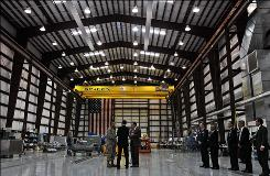 President Obama, center, last month visited the SpaceX Falcon 9 facility at Kennedy Space Center.