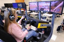 High school freshman Abby McCormick uses a simulator in a driver education class last fall in Cumming, Ga. A three-year Connecticut study has set out to prove that simulators reduce crashes among teenagers by 25%.