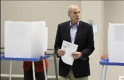 Senate GOP candidate Dan Coats casts his vote in Indianapolis on Tuesday.