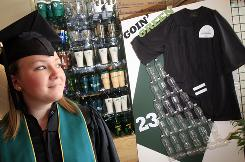 University of Vermont bookstore employee and college freshman Nicole Walker, 19, models a graduation cap and gown made of recycled materials next to the store display showing that 23 water bottles equal one cap and gown in producing the graduation day attire.