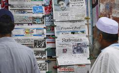 Pakistanis read morning newspapers carrying headline stories on the arrest of a suspect in New York City's Times Square bomb attempt, at a newspaper stall in Islamabad, Pakistan on Wednesday, May 5.