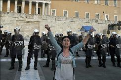 A protester shouts in front of the Greek Parliament during a protest Thursday.