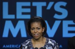 Michelle Obama speaks about the findings of the Childhood Obesity Task Force in Washington on Tuesday. In February, the first lady launched the Let's Move campaign.