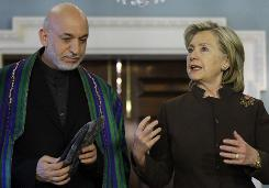 Afghanistan's Hamid Karzai and Secretary of State Hillary Clinton met Tuesday in Washington. Clinton admitted Tuesday that U.S. relations with Afghanistan were strained but said the U.S. will stand behind the country after the last American servicemembers have left.