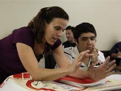 Lizette Foley teaches John Tucci, 21, and other students during a preparatory math class at Broward College in Davie, Fla.
