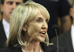 Arizona Gov. Jan Brewer speaks in Phoenix.