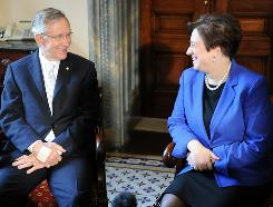 Supreme Court Nominee Elena Kagan speaks with Senate Majority Leader Harry Reid for her first of many meetings with senators on Wednesday.