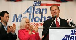 West Virginia Rep. Alan Mollohan, right, is applauded by his wife, Barbara, and son Andy during his concession speech in Morgantown, W.Va., on Tuesday.