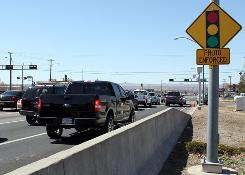 Traffic passes a red-light camera on Paseo del Norte, a busy street in Albuquerque, in March.