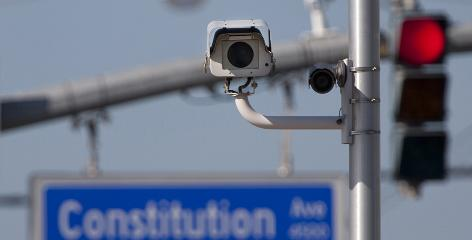 An automated traffic enforcement camera records red-light violations at an Interstate-10 off-ramp in Baton Rouge