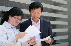Lawyers Liu Wei, left, and Tang Jitian learned this month that their licenses had been revoked after their defense of a Falun Gong follower.
