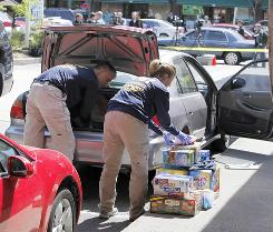 FBI investigators replace items they had removed from a car at a service station in Brookline, Mass., on Thursday in connection with the failed New York Times Square car bomb.