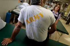 Iraq war veteran Robert Wake, who was diagnosed with post-traumatic stress disorder, talks to physical therapist Nicole Bormann before a session in the VA Medical Center on Aug. 10, 2009, in St Louis, Mo. Wake served in Iraq from 2003-2004 and was seriously wounded by a mortar shell in Najaf.