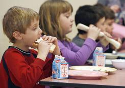 This Feb. 3, 2010, photo shows students eating lunch at Sharon Elementary School in Sharon, Vt. The school is part of the national Farm to School program, aimed at getting healthier meals in school cafeterias and improving student nutrition.