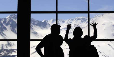 Visitors to the Johnston Ridge Observatory at Mount St. Helens National Volcanic Monument look out at the volcano last week.