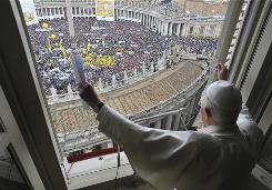 Pope Benedict XVI blesses thousands of faithful in St. Peter's Square from the window of his studio at the Vatican on Sunday.