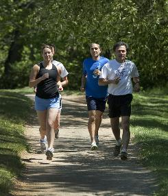 Danny Dreyer, front right, demonstrates his ChiRunning technique, which focuses on landing on the center of the foot rather than a heel strike, in Asheville, N.C. Running along are Shelly Schmidt, left, Liz Frost, behind Schmidt, and Jeff Carnivale, employees of Dreyer's ChiLiving company.