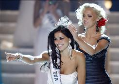 Miss Michigan Rima Fakih reacts as she is crowned Miss USA 2010 on Sunday in Las Vegas.