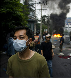 Anti-government protesters gather in a street near Ding Daeng intersection in Bangkok on Monday.