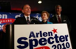 Sen. Arlen Specter, D-Pa., concedes defeat in the Democratic primary as his wife Joan, center, and son Shanin watch in Philadelphia Wednesday night.
