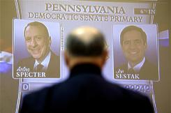 A man views returns on large screen at Rep. Joe Sestak's, D-Pa., primary night watch event at the Valley Forge Military Academy College in Wayne, Pa., on Tuesday.
